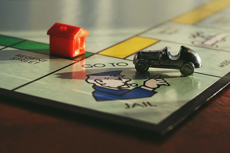 Monopoly piece landing on 'Go Back To Jail' spot